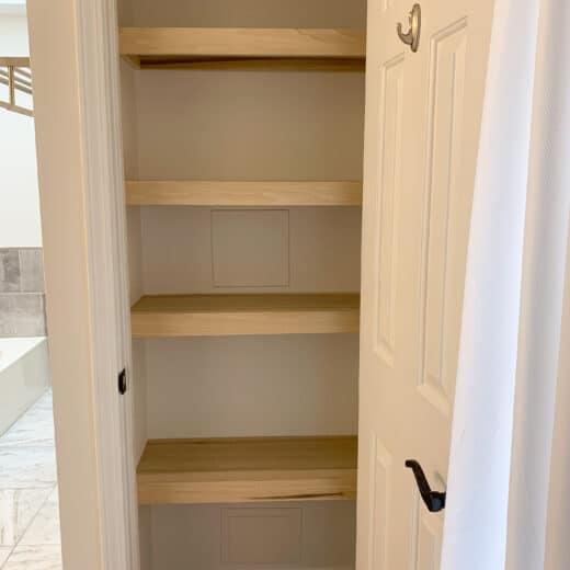 Linen closet with wood shelves