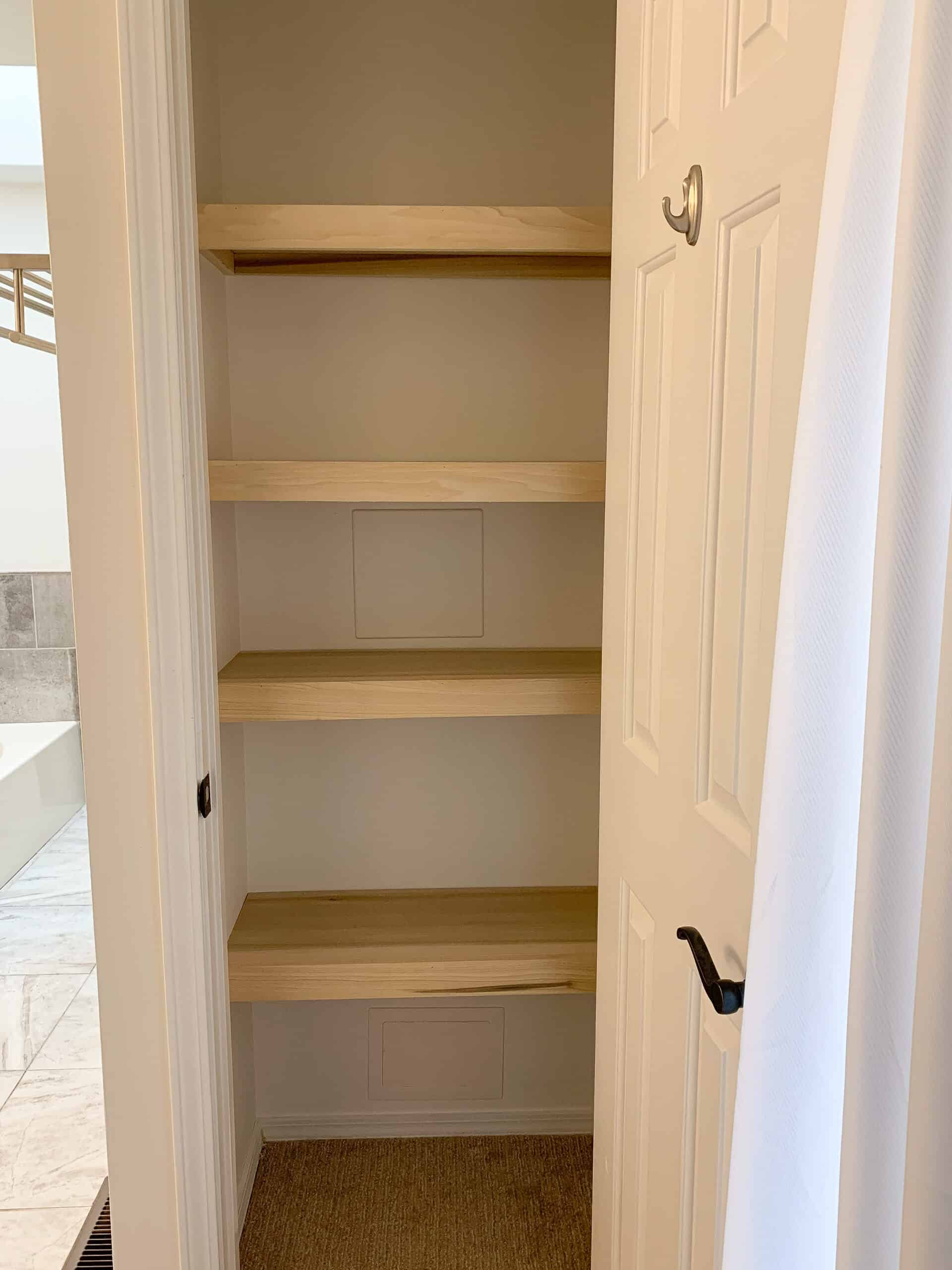 Linen closet with wood shelves
