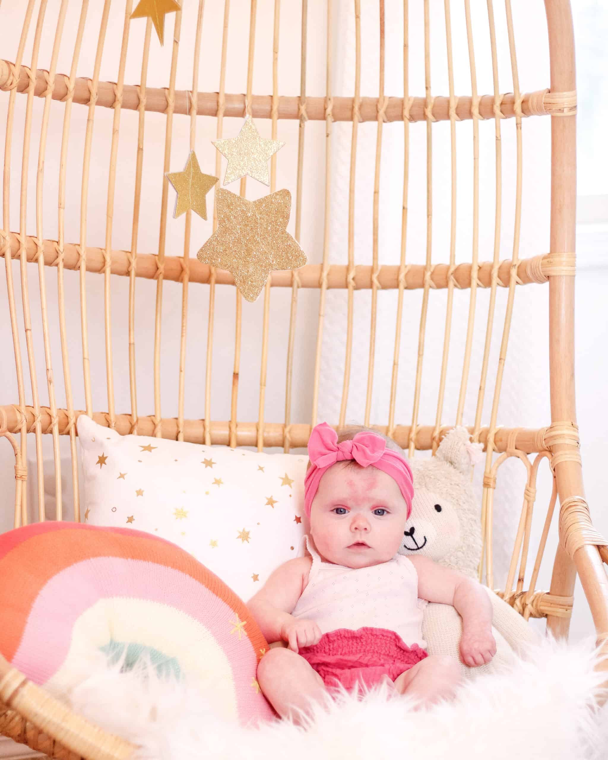 4 month old baby in rattan chair
