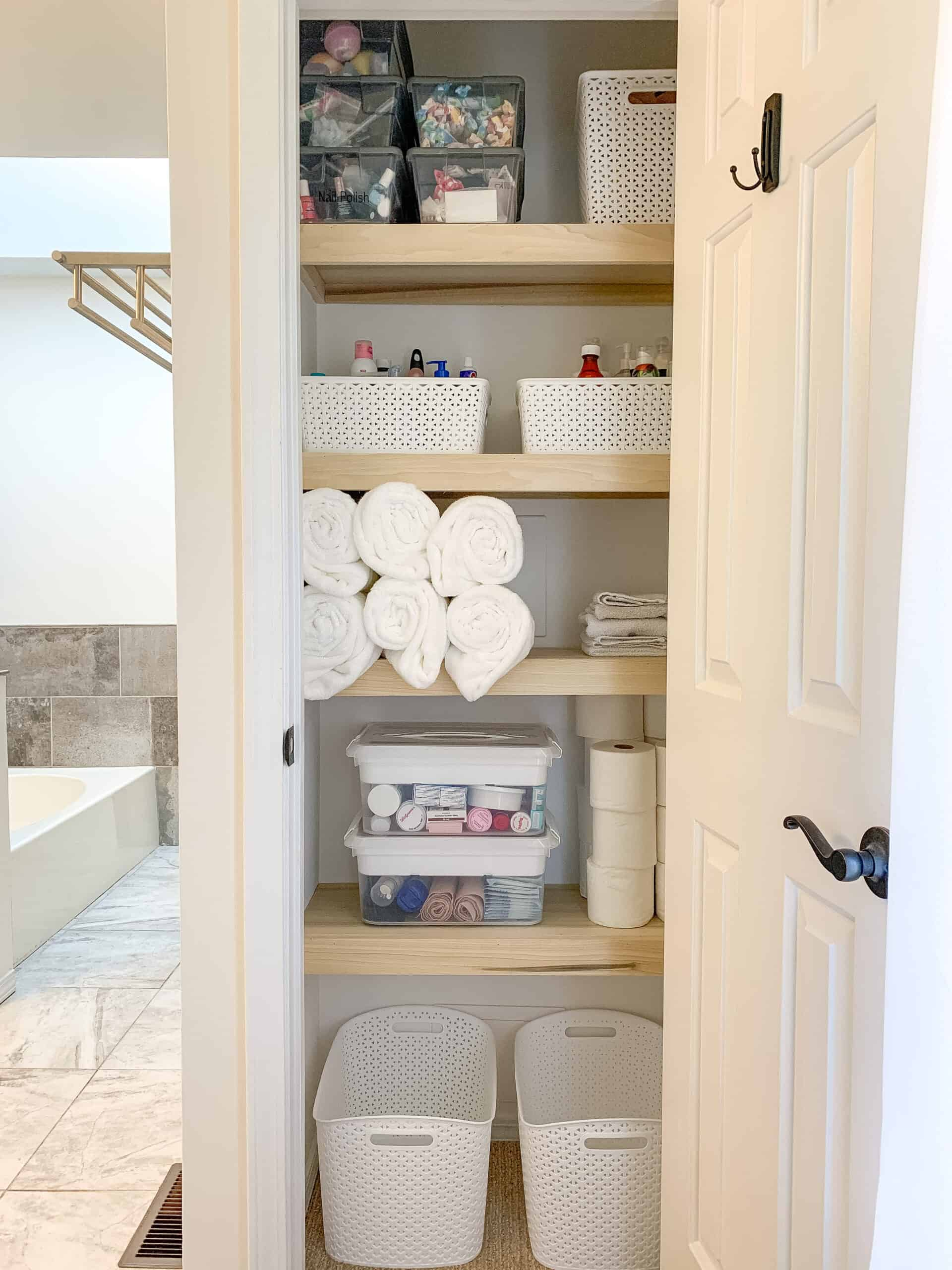 Organized Linen Closet with DIY Wood shelves