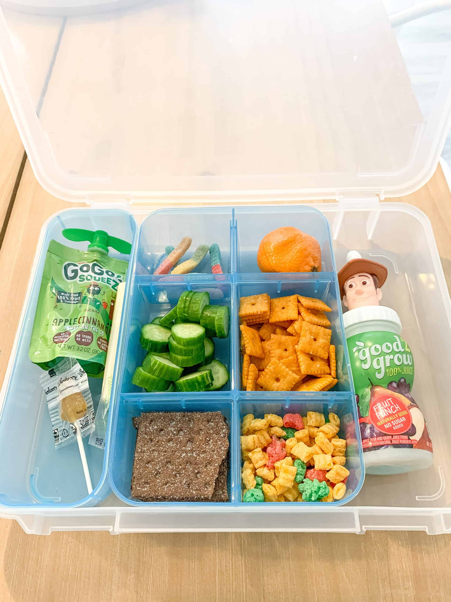 Plastic container with compartments for snacks