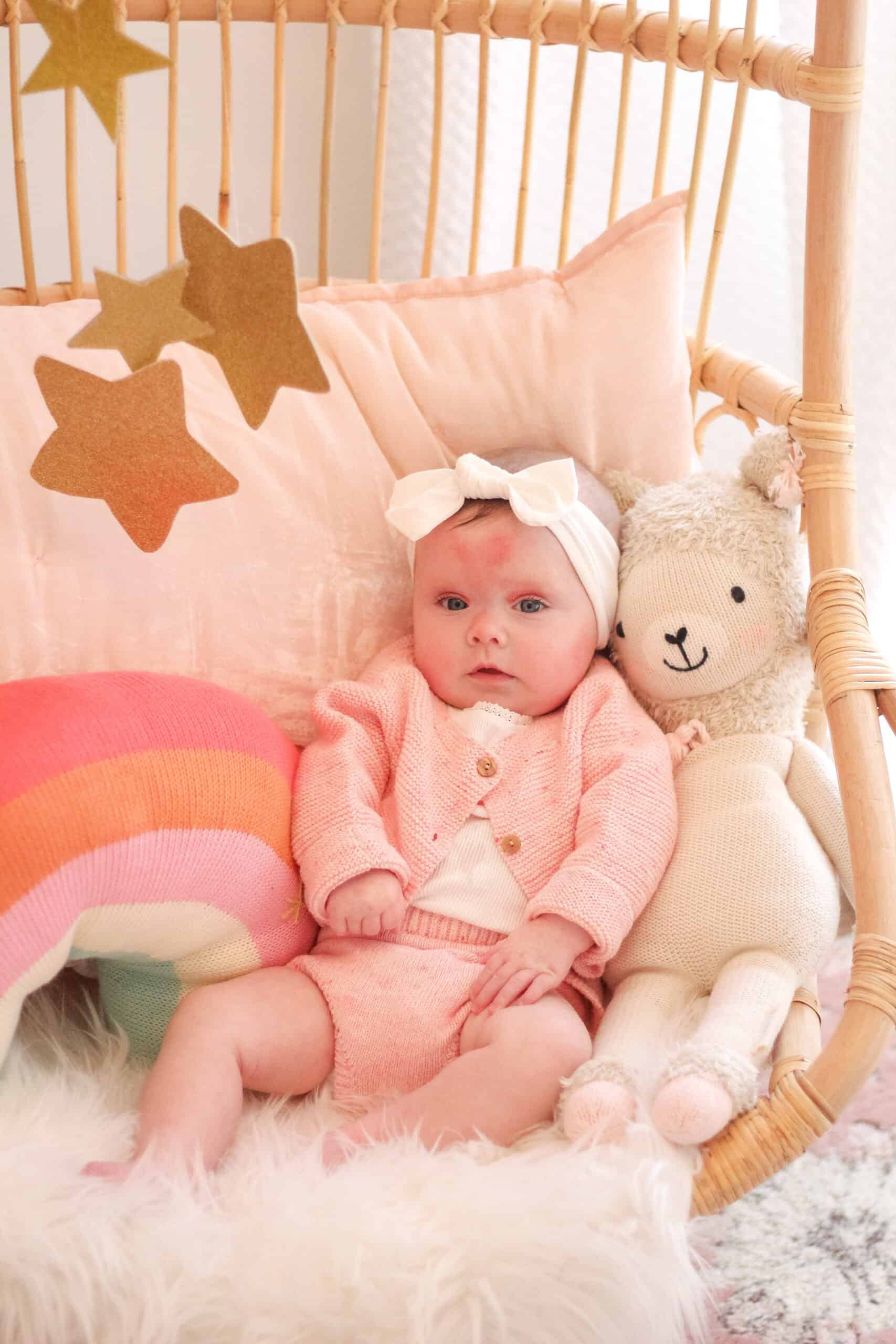 5 month old baby girl in Serena and lily chair