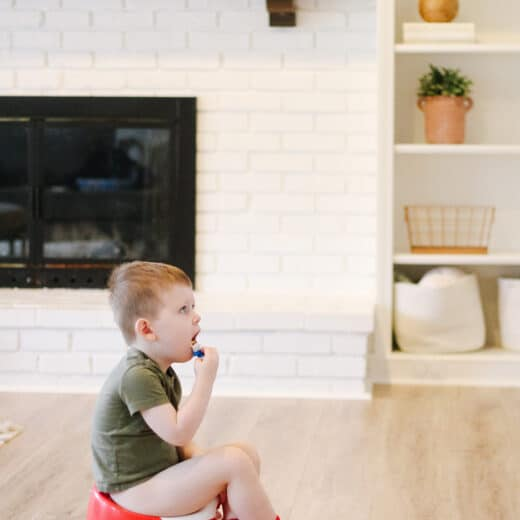 little boy potty training sitting on potty