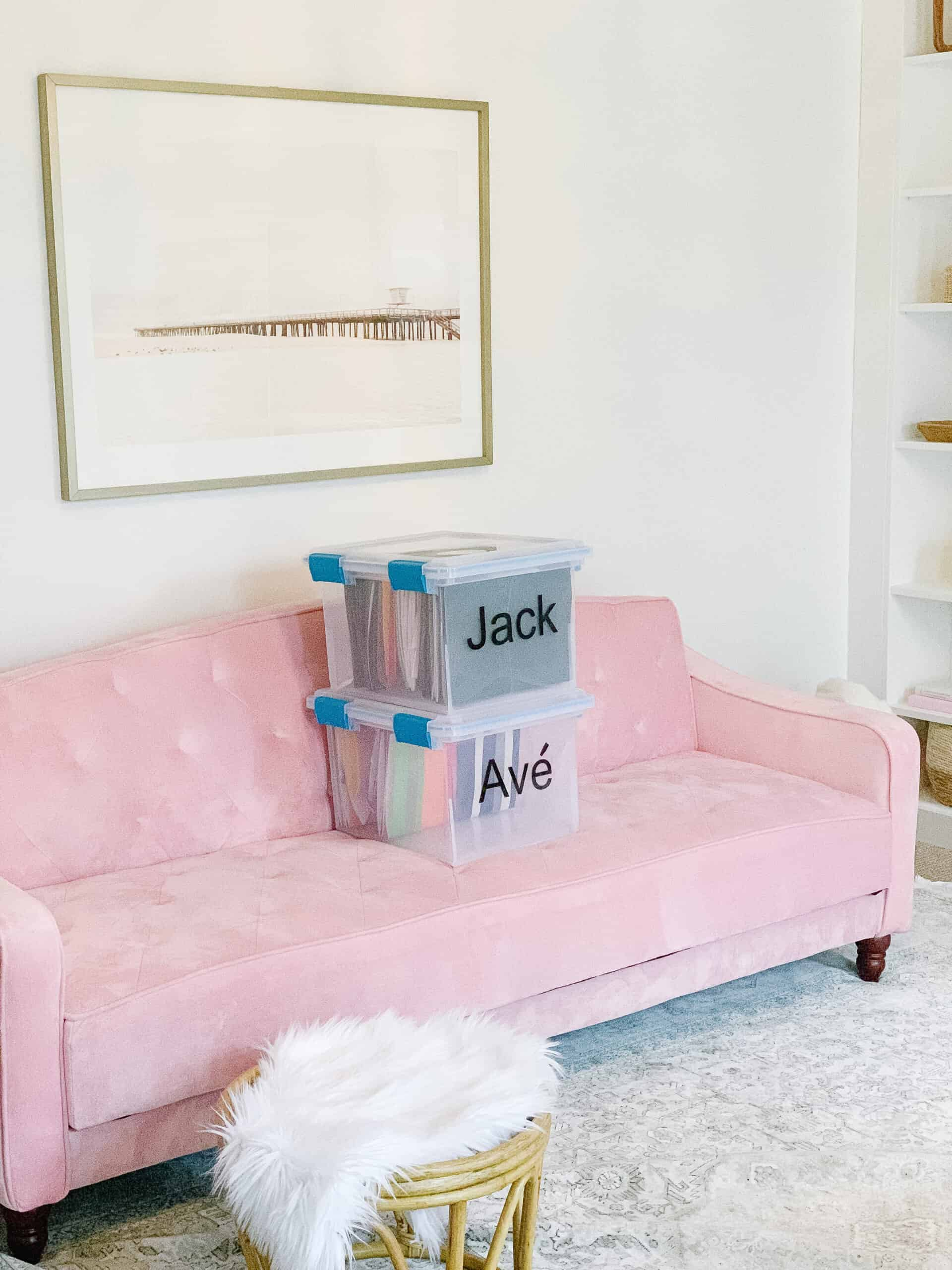 school work bins on pink couch
