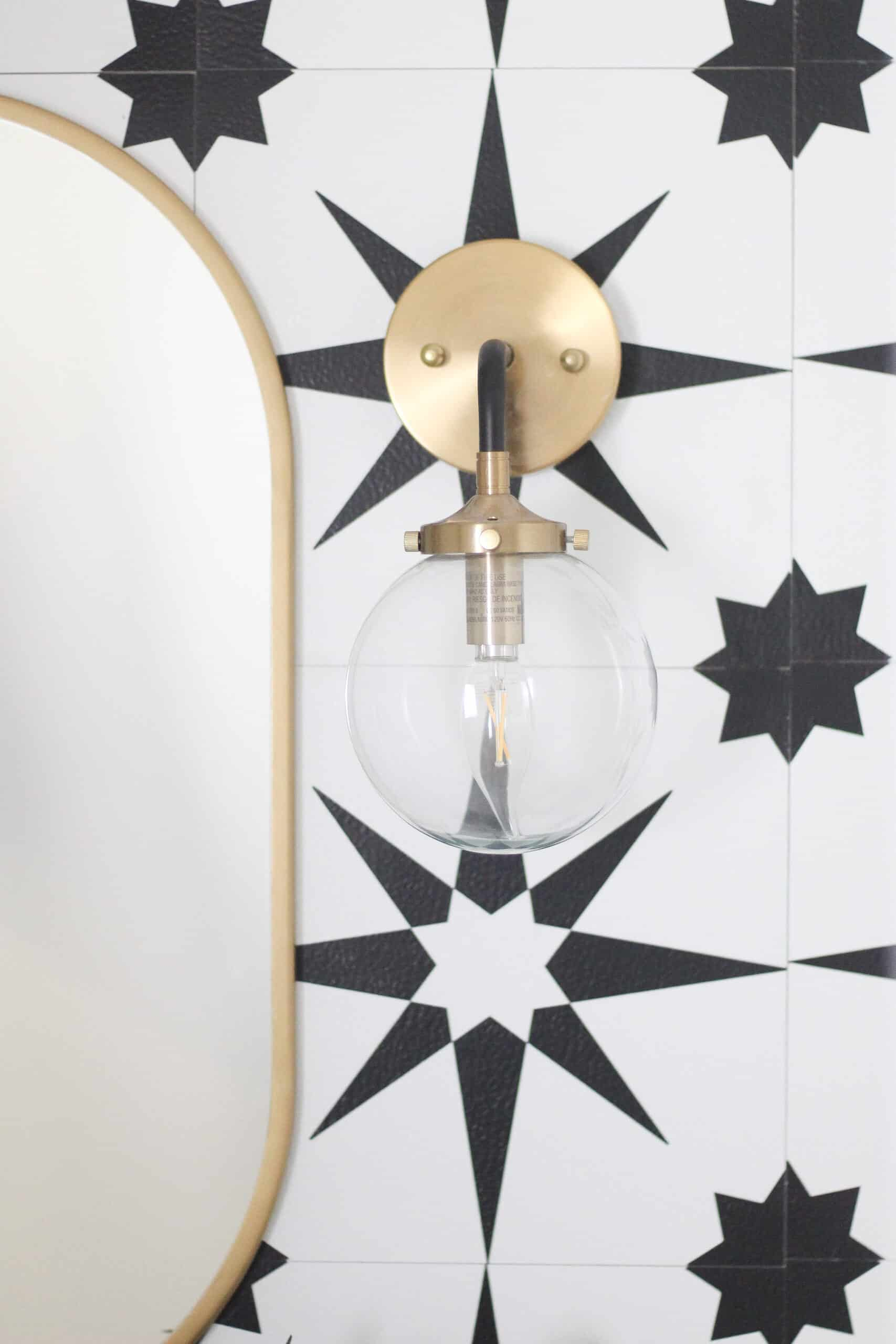 Gold and black wall sconce with gold mirror