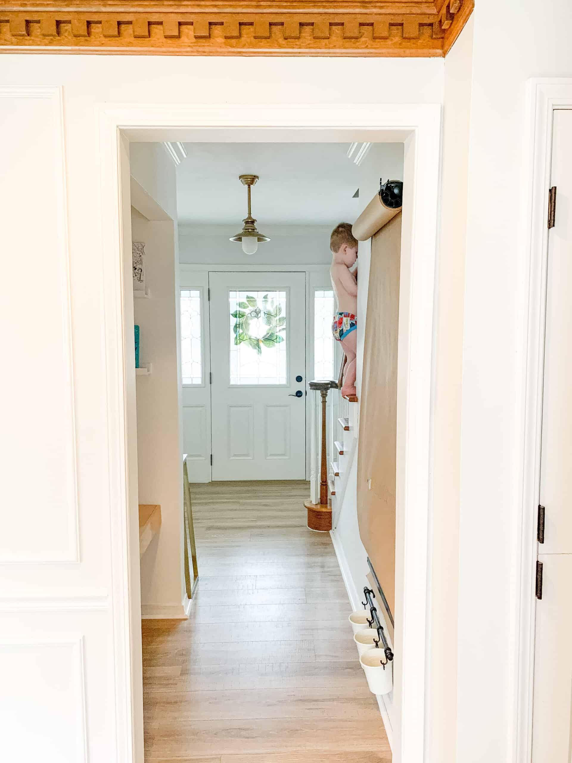 little boy in underwear climbing stairs