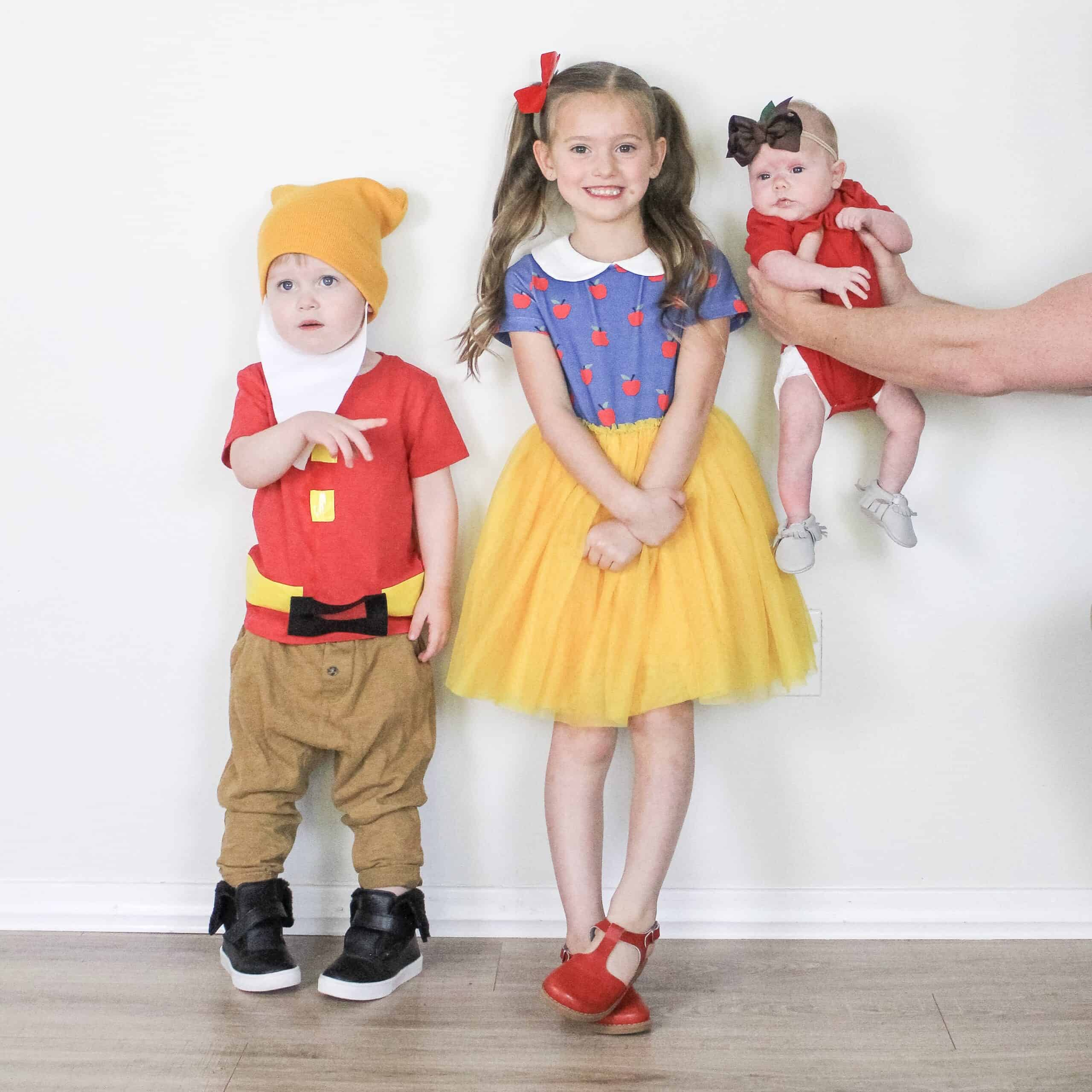 Snow White, a dwarf and apple costume