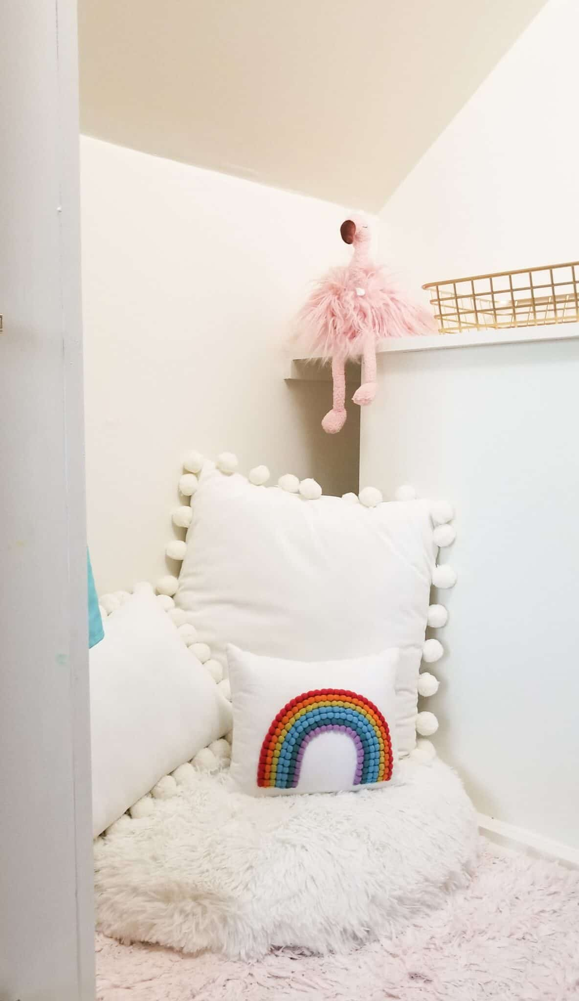 rainbow pillow in under stairs nook