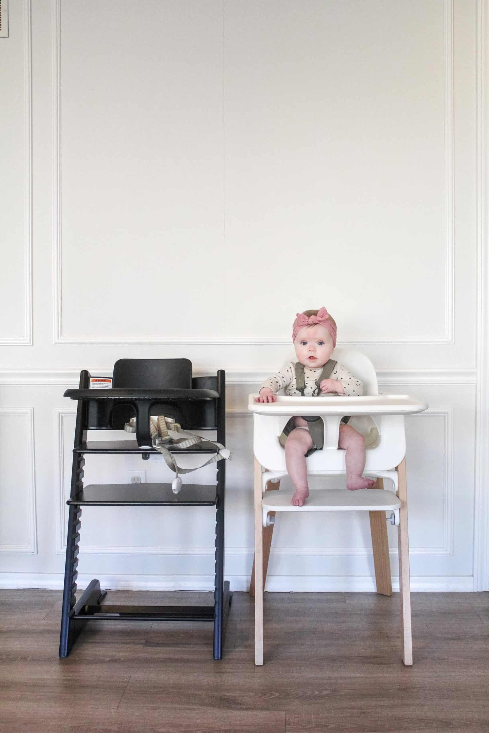 Baby in Stokke high chairs side by side