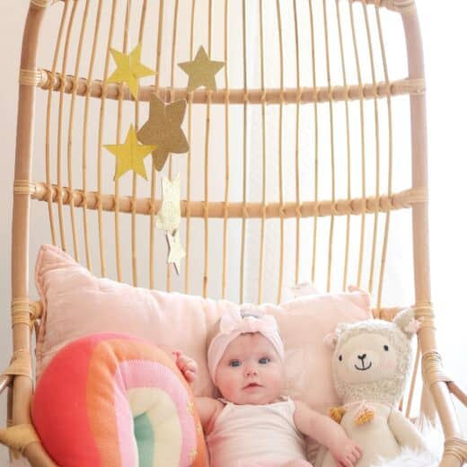6 month old baby in Serena and lily hanging chair
