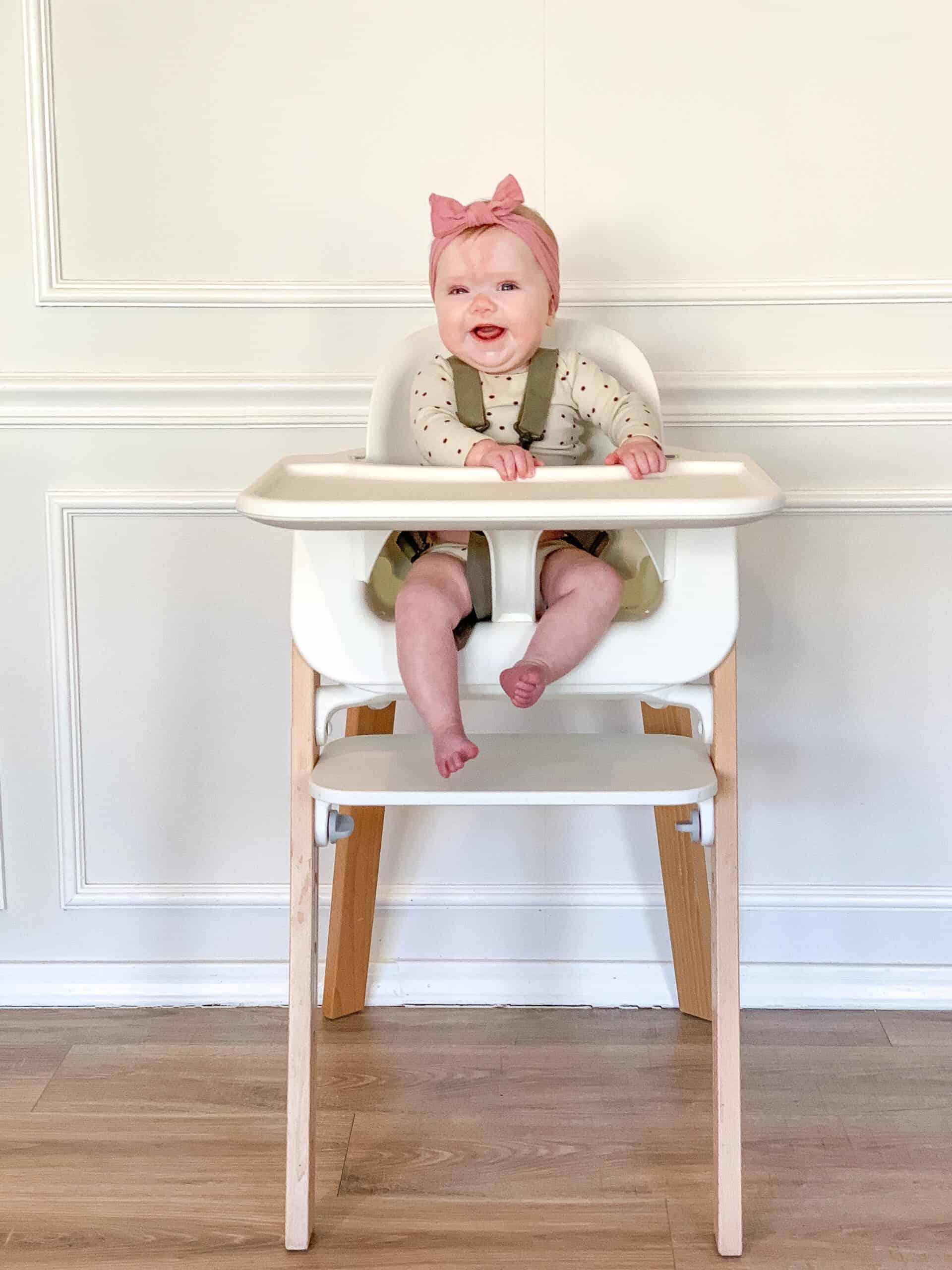 baby girl in Stokke Tripp Trapp Highchair