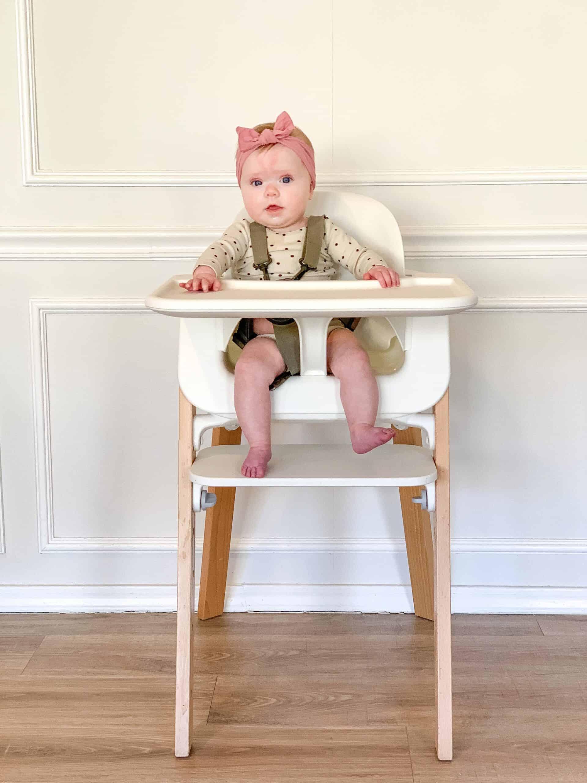 Baby girl in Stokke Steps Highchair