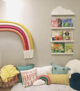 DIY rainbow on wall by book shelves