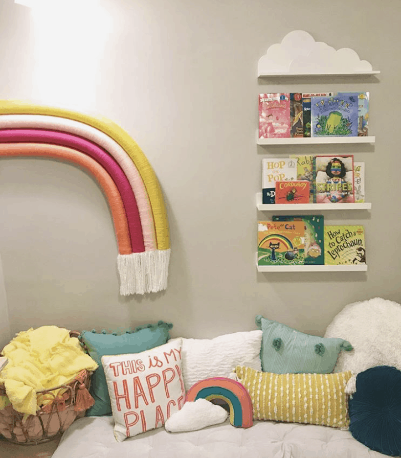 DIY rainbow on wall by book shelves