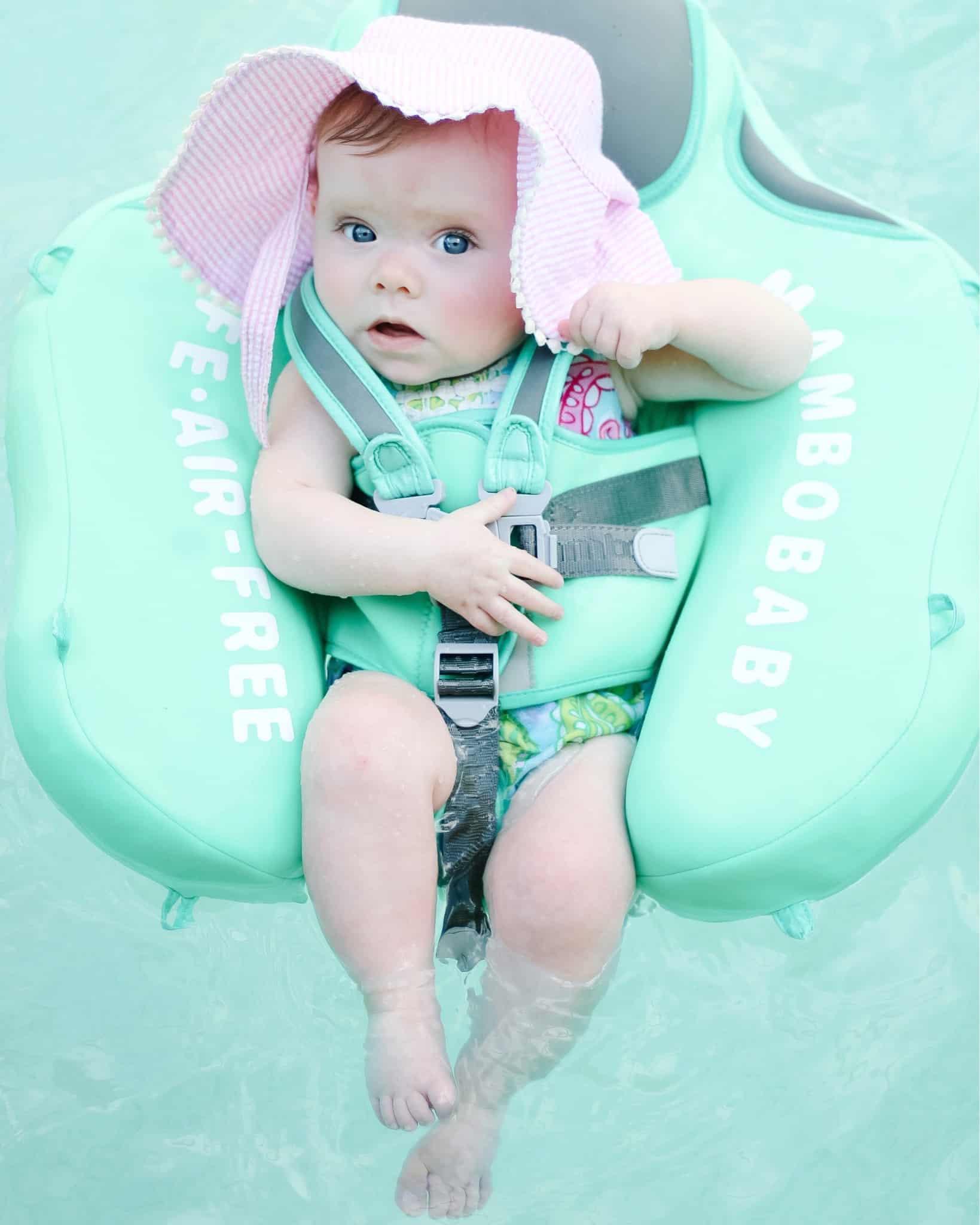 baby girl in pool float