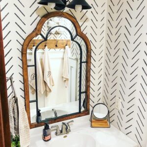 black and white stencil wall in bathroom