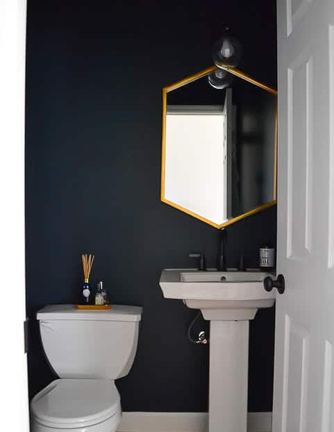 navy blue and gold powder room