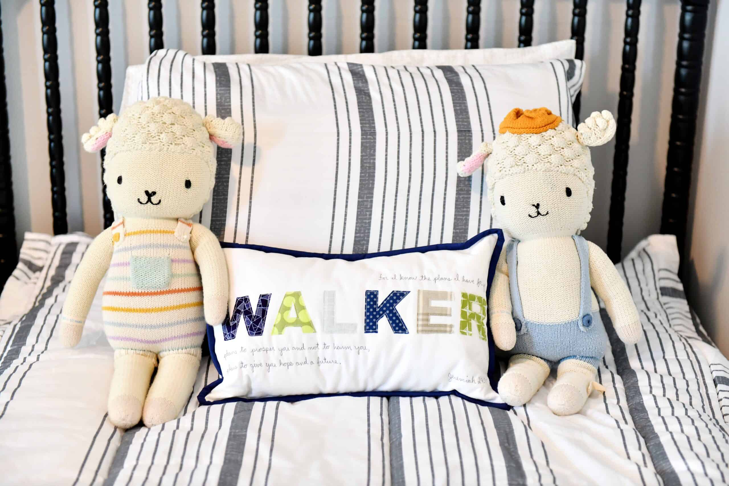 Boys bed with name pillow and cuddle and kind dolls