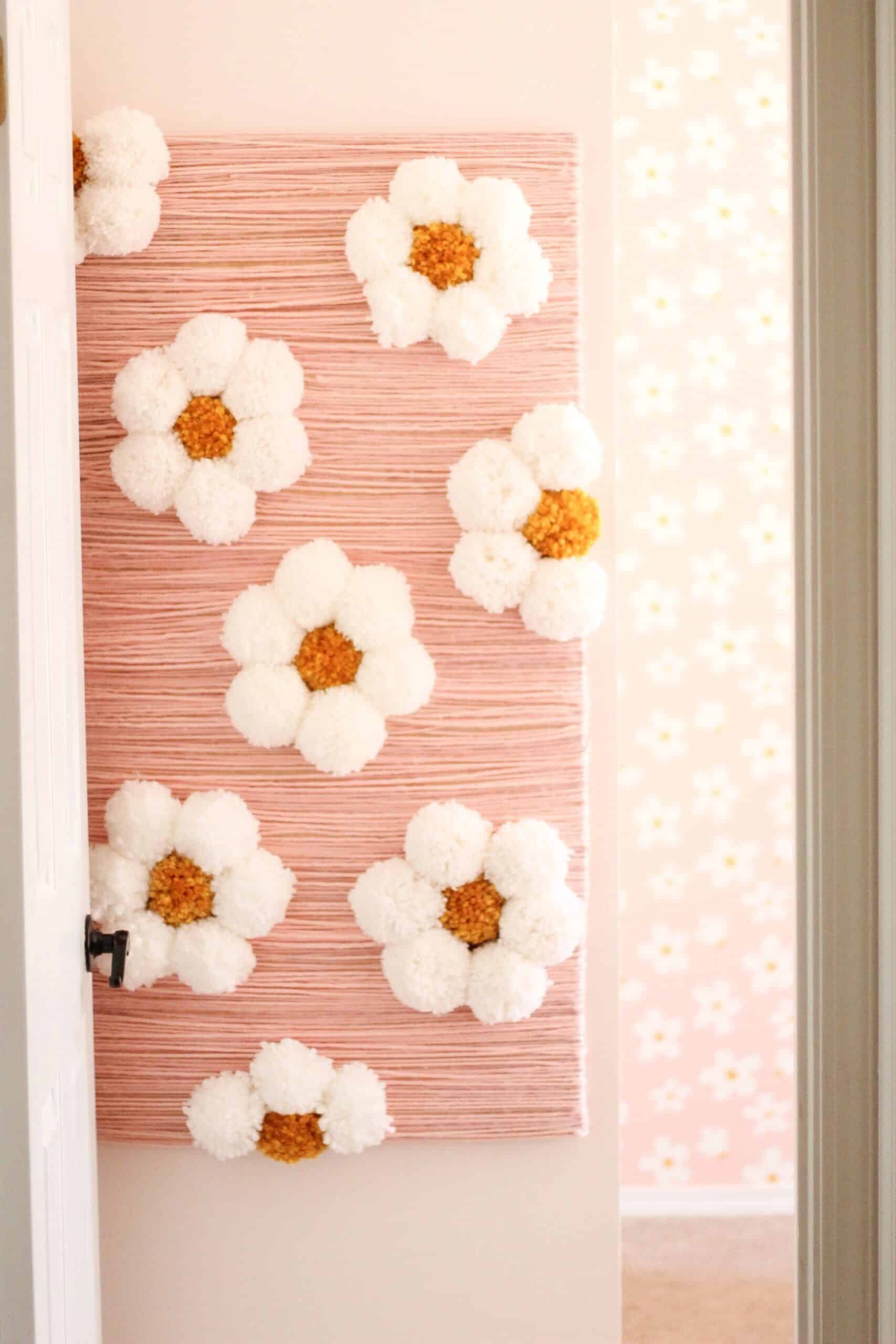 pom pom daisies for a DIY flower wall