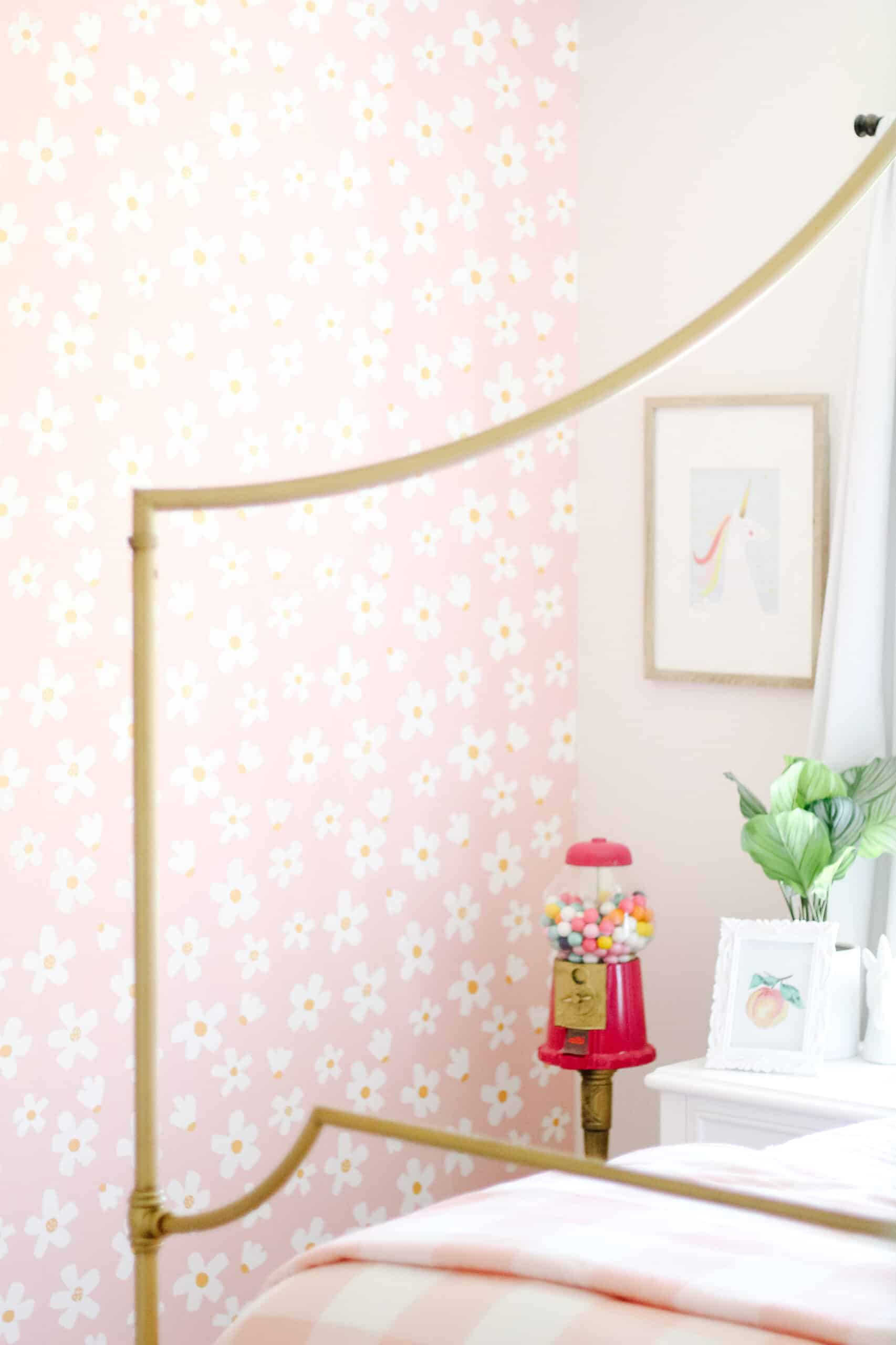 room with pink gumball machine and daisy wallpaper