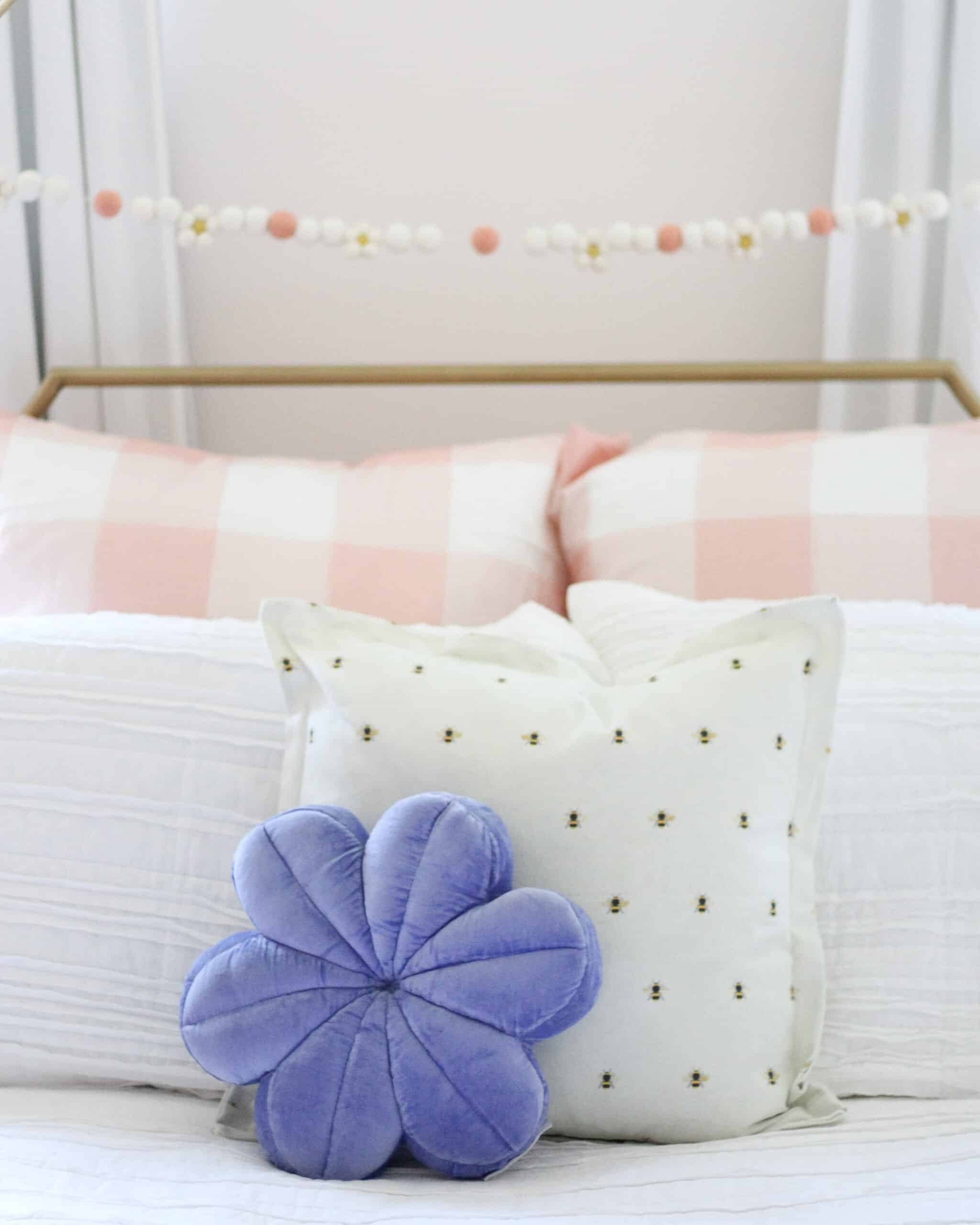 girls bedding with bee pillow and flower pillow