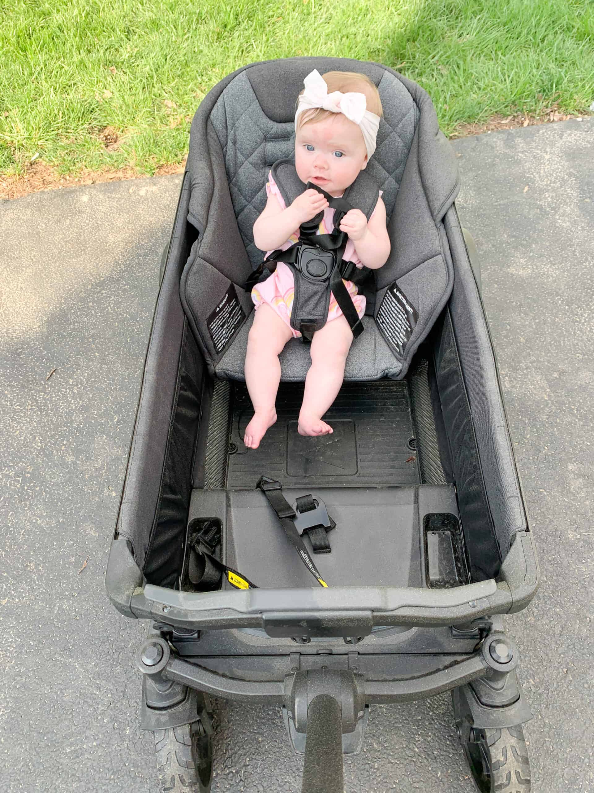 Baby girl in Veer wagon toddler seat