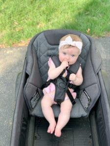 Baby girl in veer cruiser toddler seat
