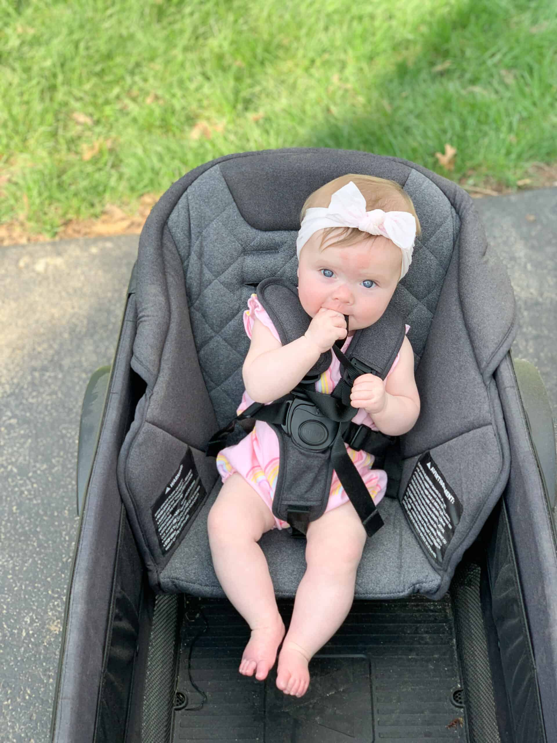 Baby girl in veer cruiser toddler seat
