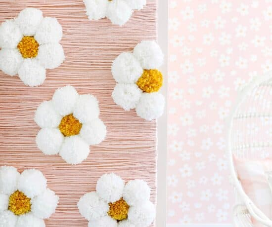 large daisy diy yarn wall art in girls bedroom