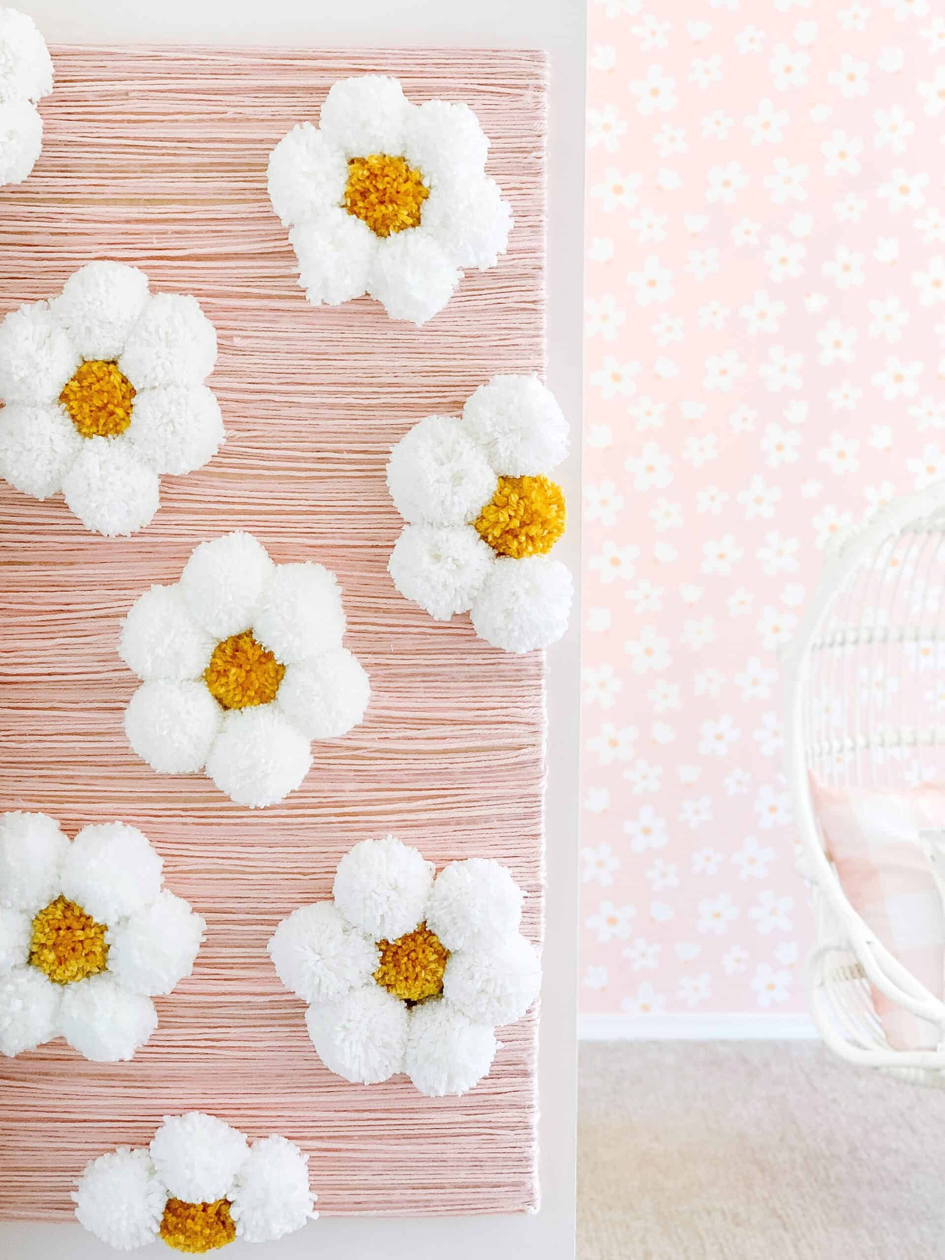 large daisy DIY flower wall in girls bedroom