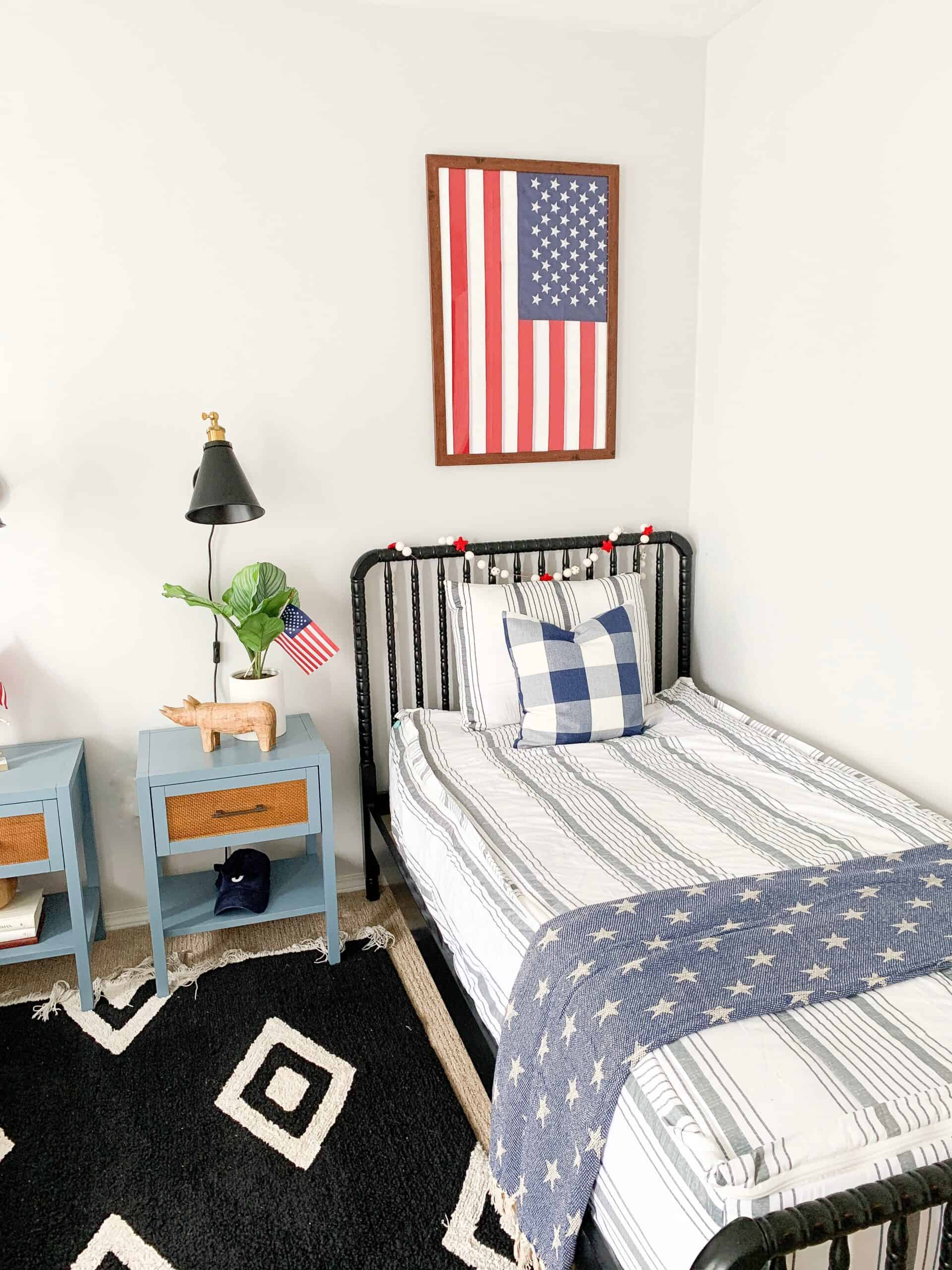 boys room with flag framed above bed