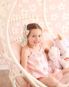little girl in hanging Serena and Lily chair