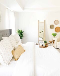 Master bedroom with ladder mirror