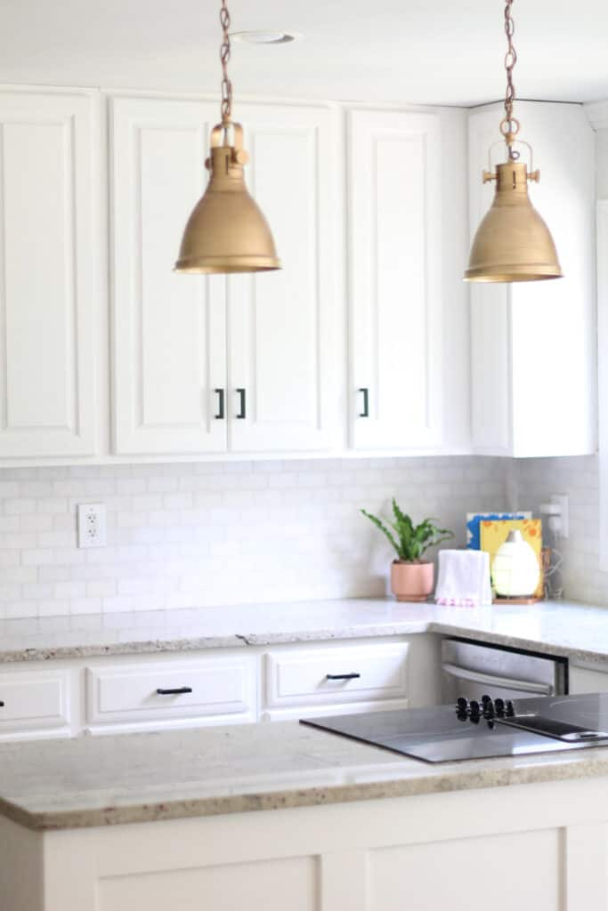 white kitchen with gold and black