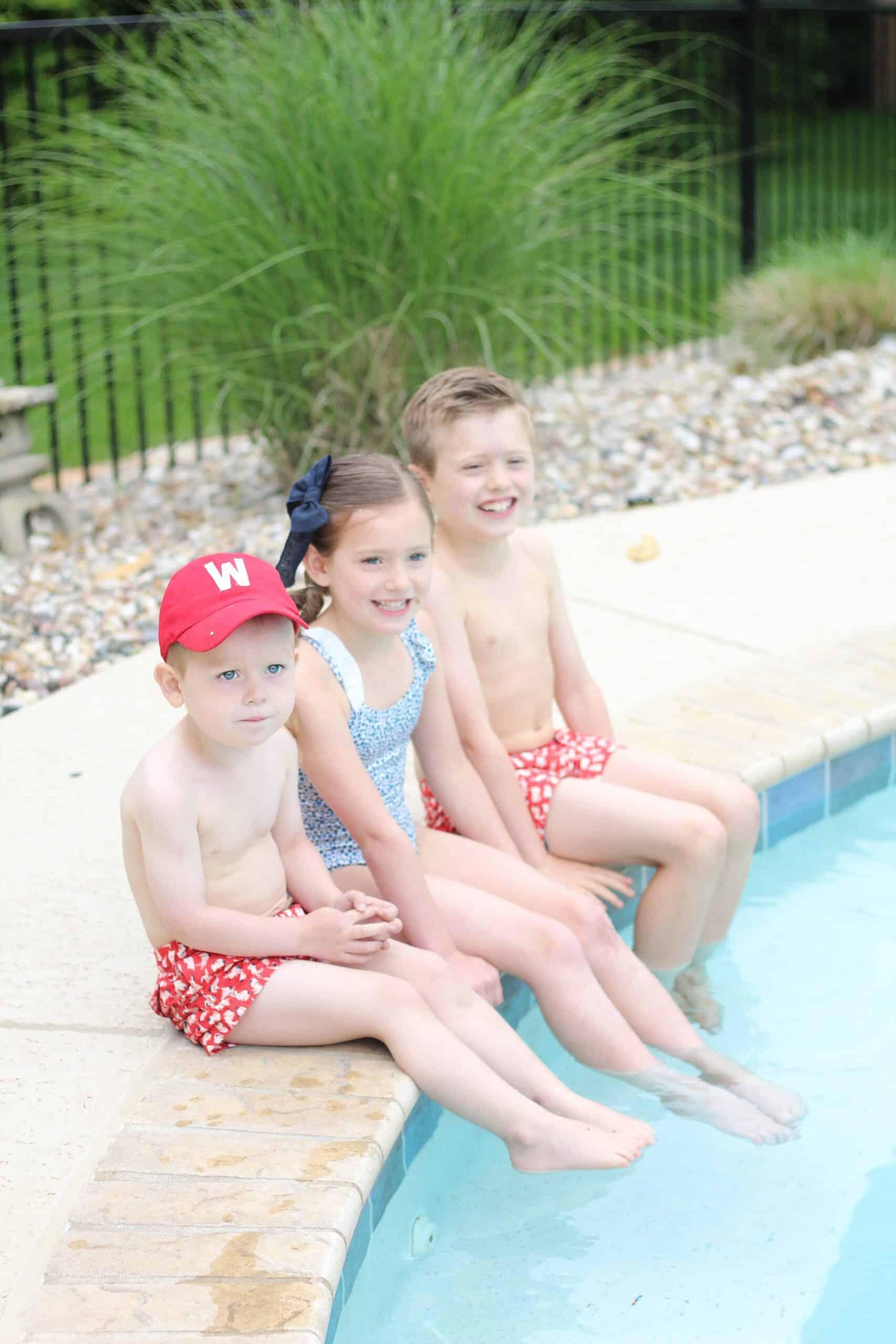 kids sitting pool side