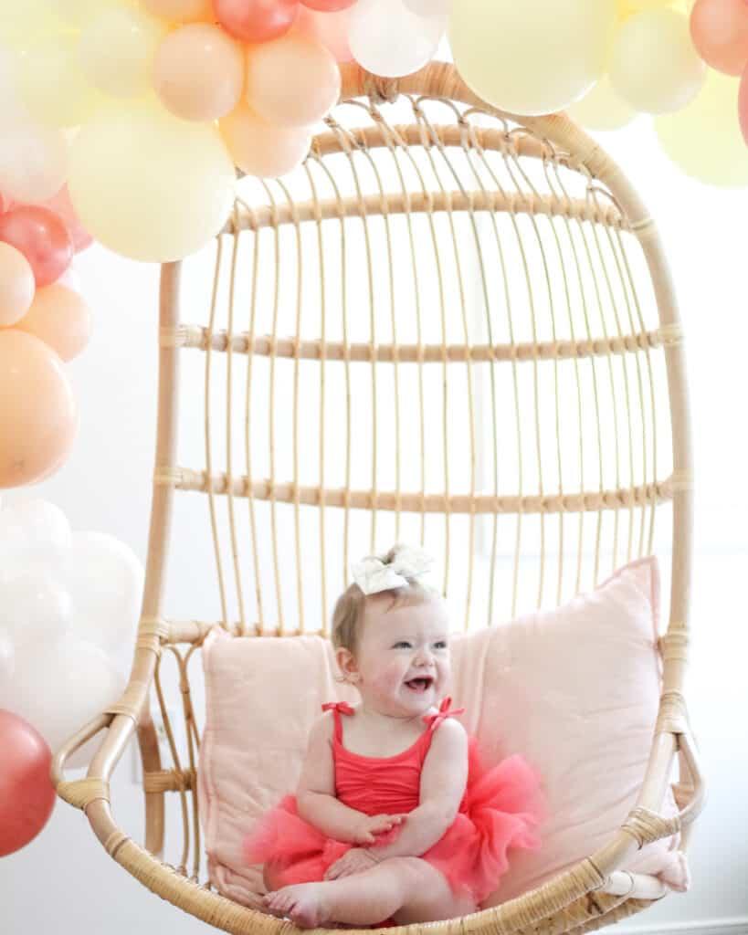 baby girl in plum tutu on her first birthday