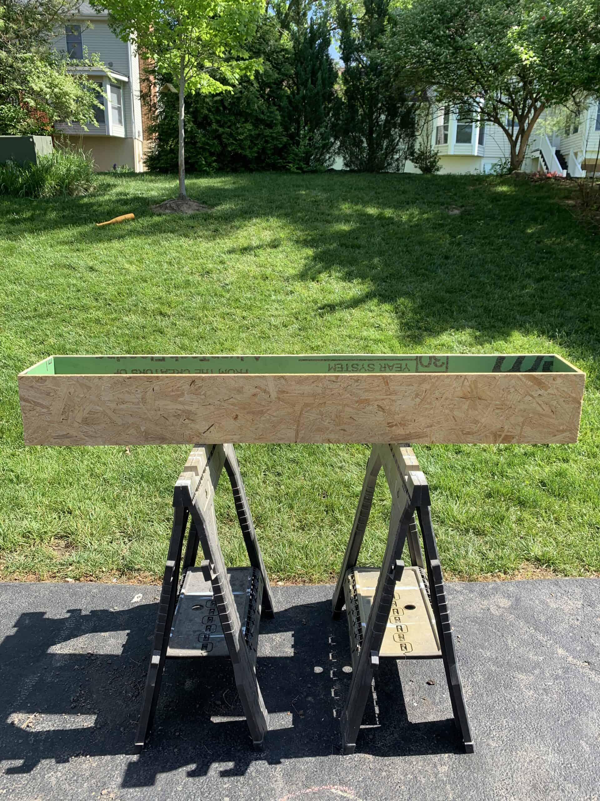 plywood planter box on saw horses