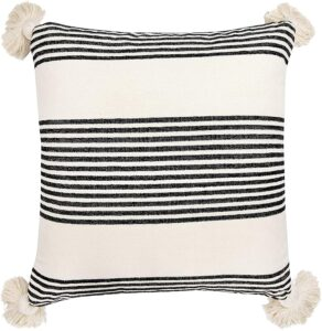 black and white striped pillow with pom moms