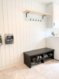 black bench in laundry room