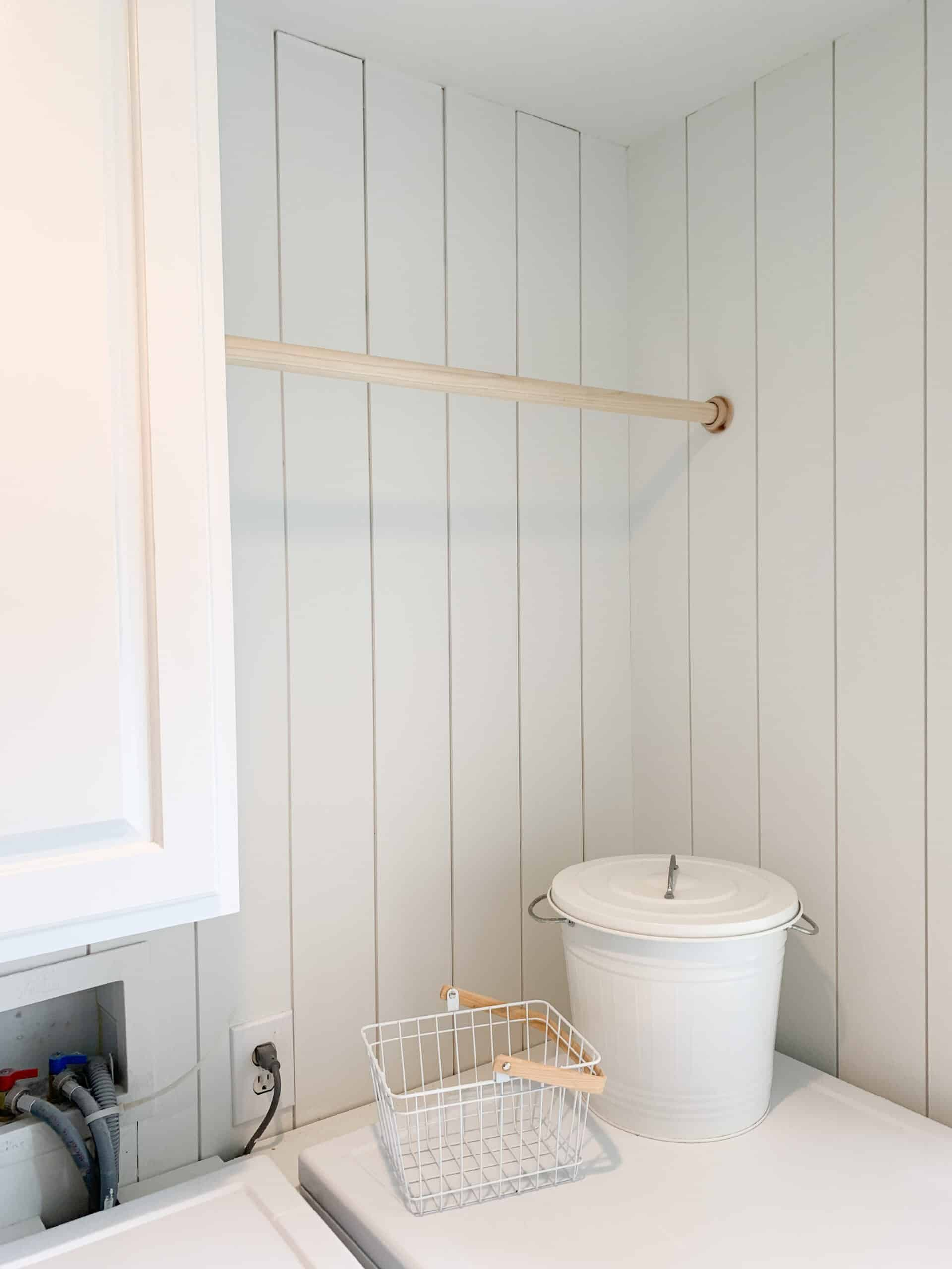 hanging wood bar in laundry room