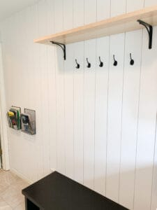 mudroom with vertical shiplap