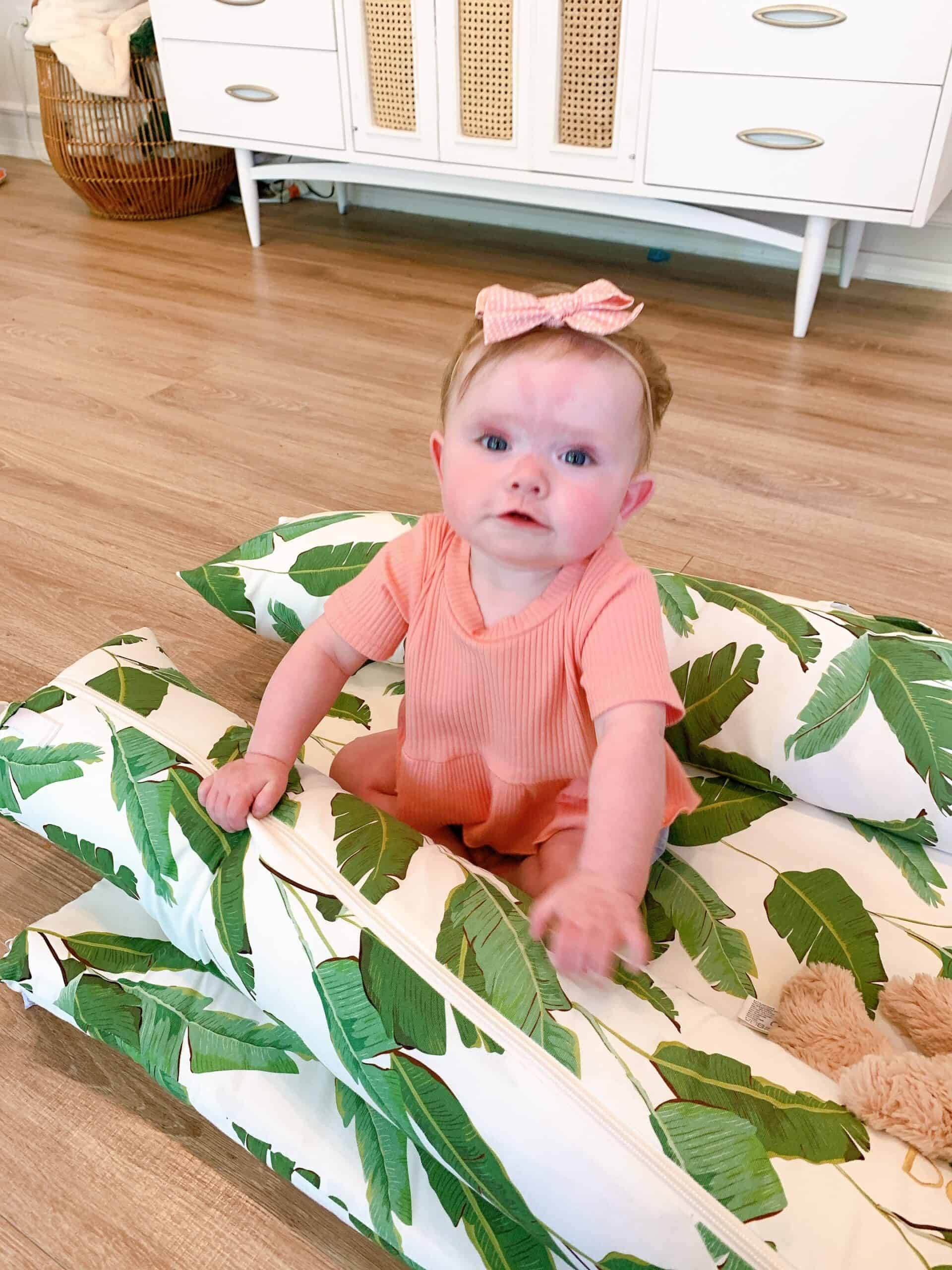 baby girl in pink outfit inside Dockatot Grand