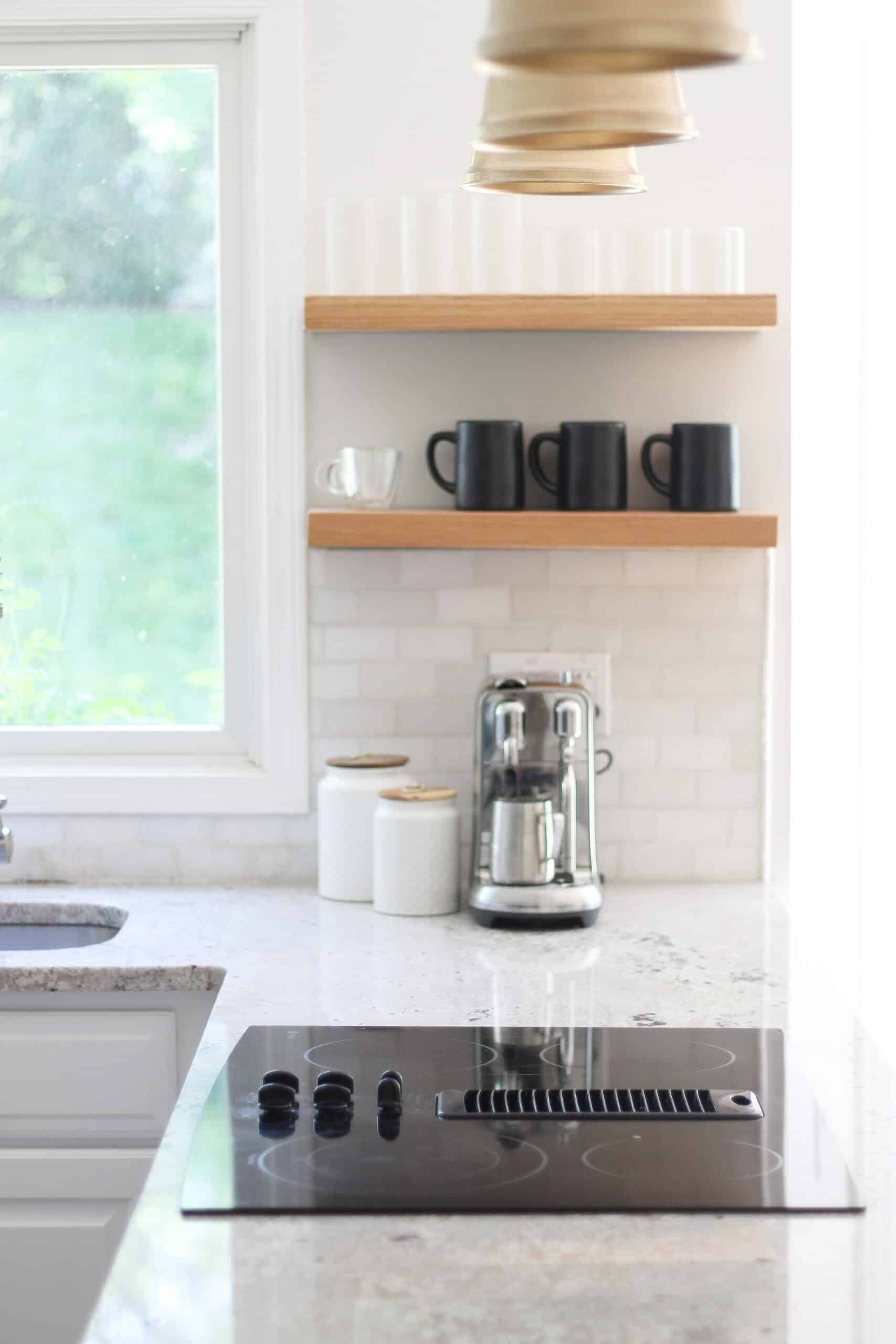 amazon cups and coffee cup in white kitchen