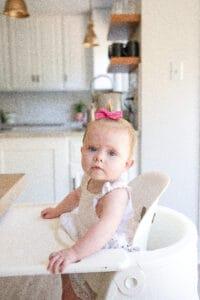 baby girl in stokke highchair