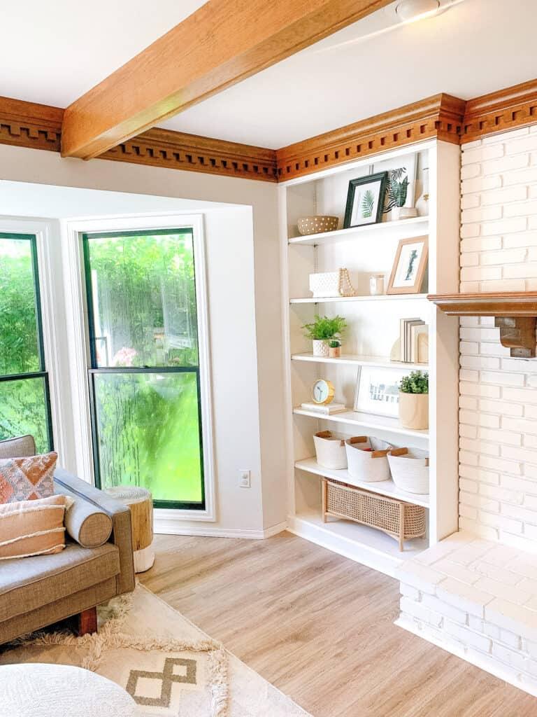 pocket of living room wth built in shelving