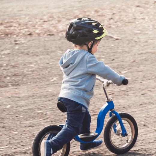 toddler on strider bike