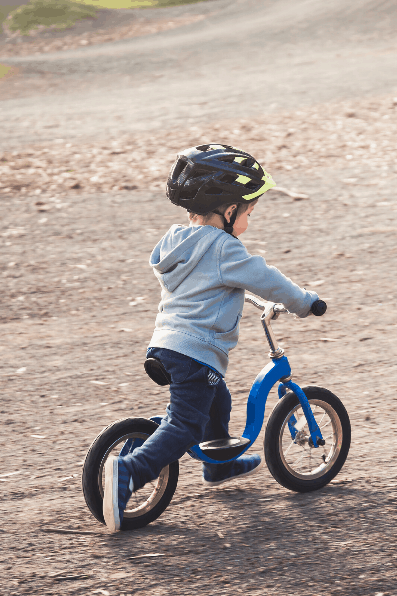 toddler on strider bike