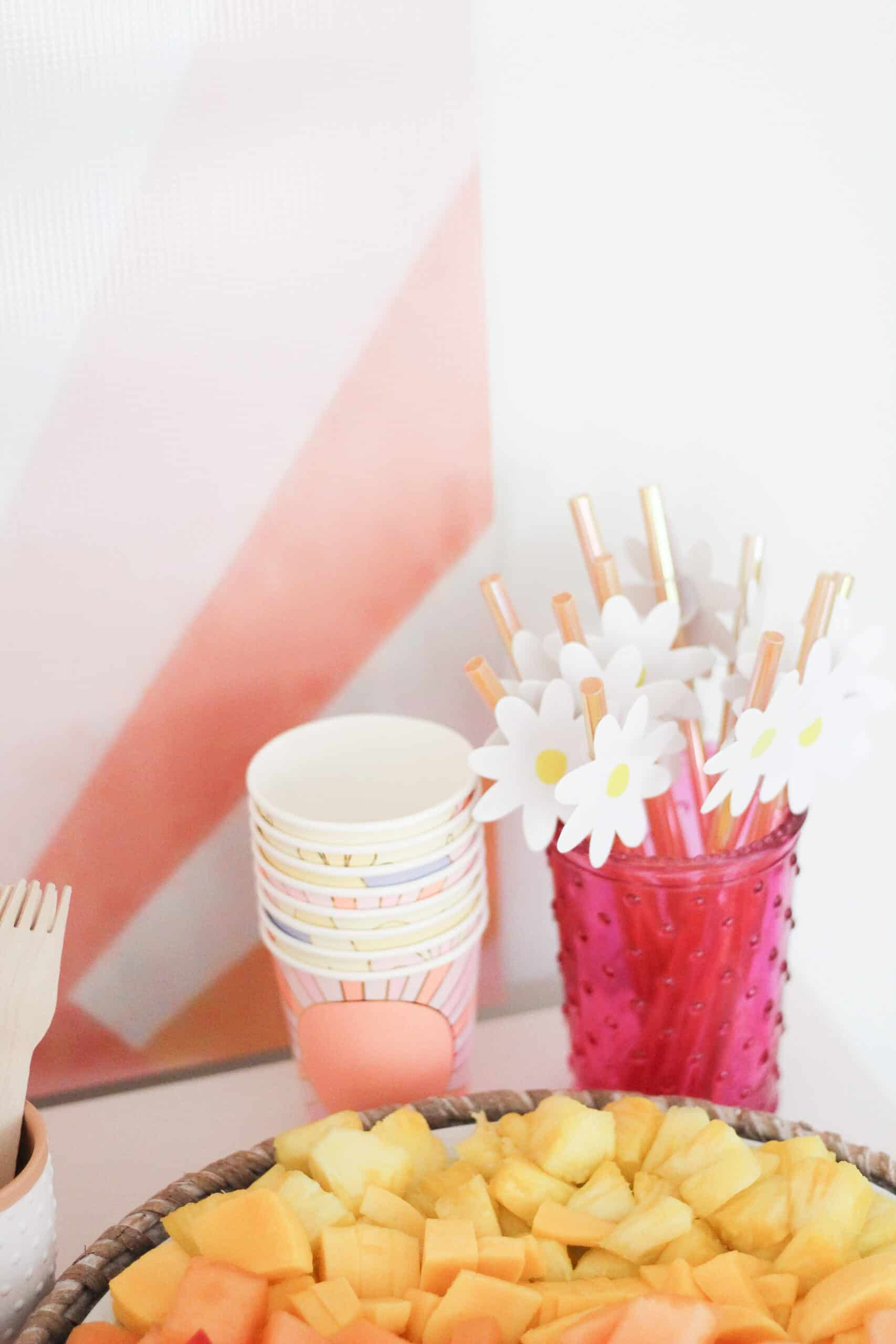 pink and yellow sun and flower party decor