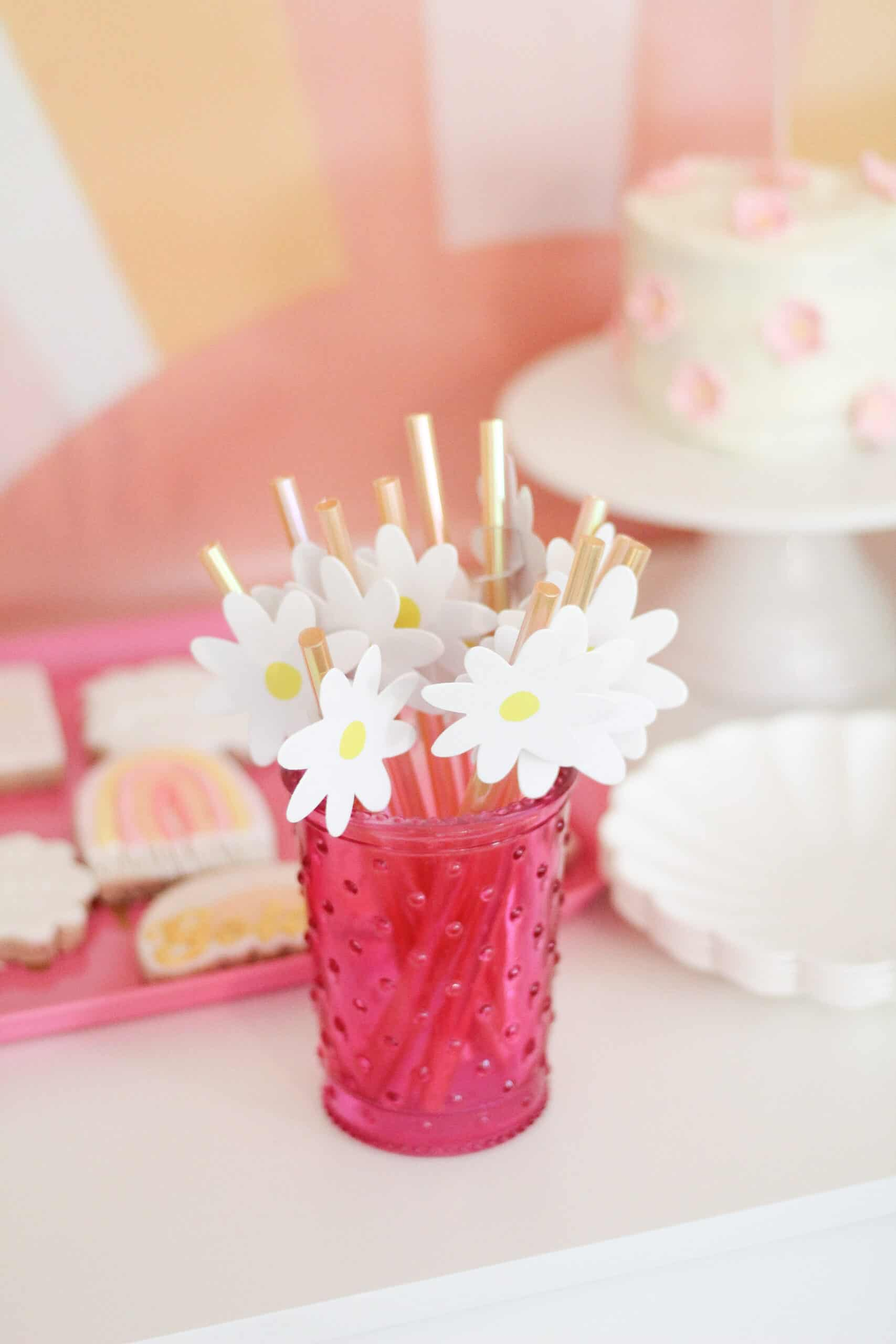 pink cup with yellow daisy straws