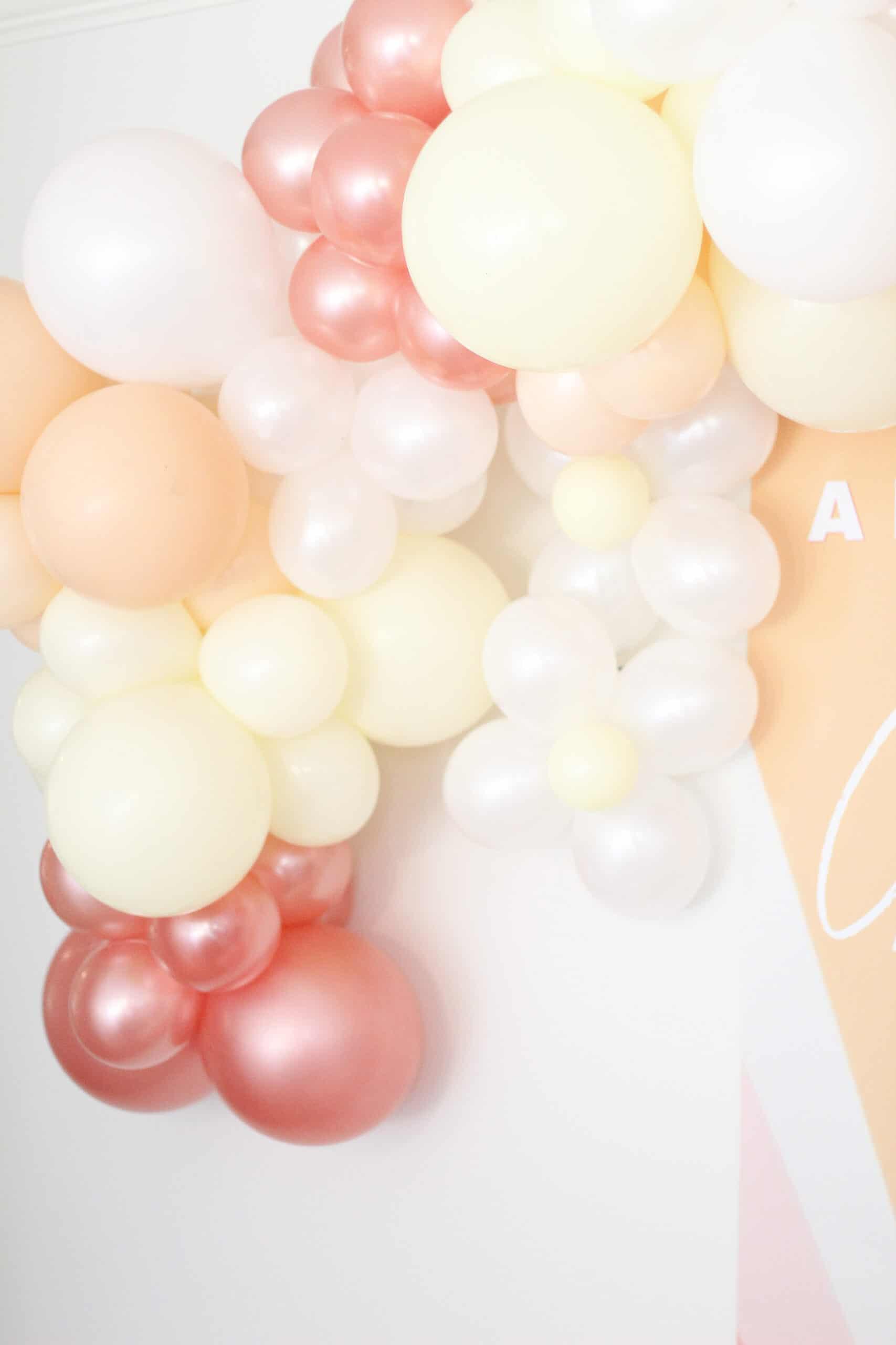pink yellow and coral balloon garland